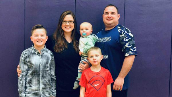 Health care workers Brittanny and Bryce Budimir live in Kankakee, Illinois, and have three children. This photo was taken before the COVID-19 pandemic prompted them to send their children to live with their grandparents.