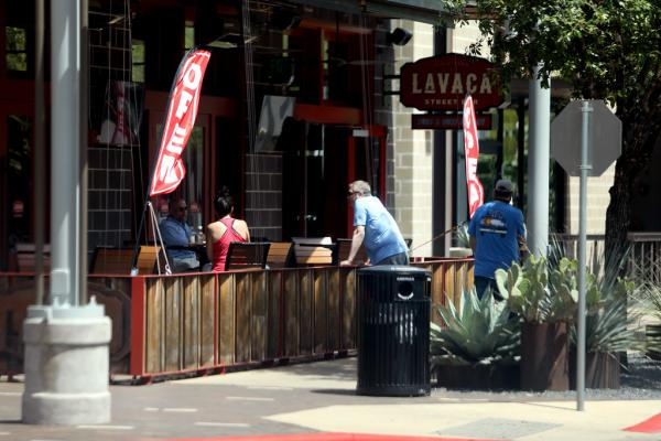 Patrons sit outside the Lavaca Street Bar in the Domain on May 1, as the Texas economy slowly reopens. For people with weak immune systems, the dangers of going out during the pandemic still exist.
