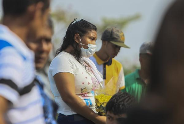 A Nicaraguan woman wears a protective mask at a cemetery funeral this week in Managua