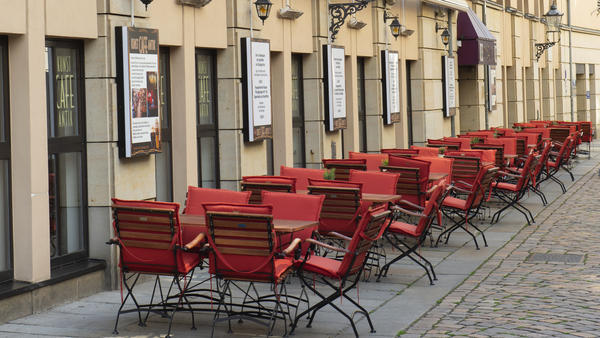 Tables and chairs stand empty Friday outside a restaurant in Dresden, Germany, as the country now faces a recession.