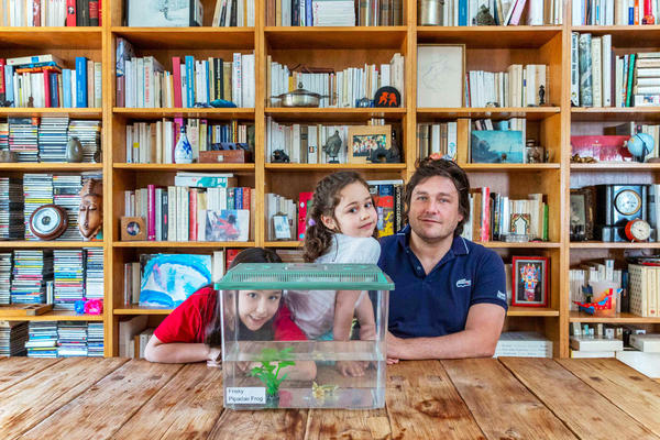 Charles Dally and his daughters Emma (center) and Cleo are fostering Frisky the frog from a science classroom at PS 58 in Brooklyn, N.Y.