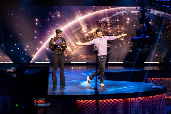 Dutch singer and television host Jan Smit dances on stage as presenters prepare for Saturday's Eurovision: Europe Shine A Light special.