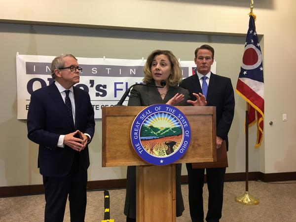 Office of Budget and Management director Kimberly Murnieks gestures during the news conference rolling out the FY 20-21 budget in March. Standing alongside are Gov. Mike DeWine (left) and Lt. Gov. Jon Husted in 2019