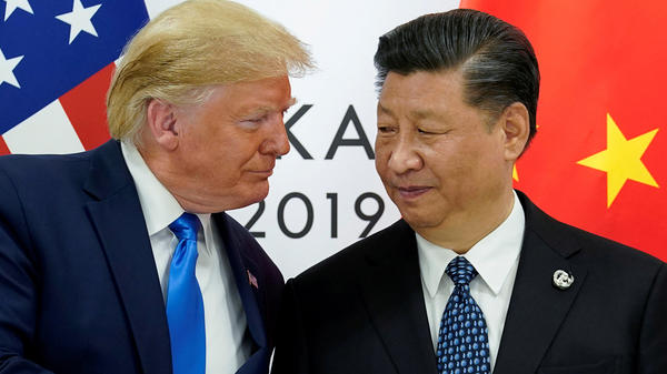 """China supports the idea of a comprehensive review of the global response to COVID-19, after it is brought under control,"" says President Xi Jinping, seen here with President Trump last summer."