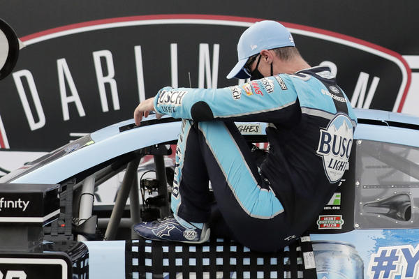 Kevin Harvick gets out of his car in victory lane after winning the NASCAR Cup Series auto race Sunday in Darlington, S.C.