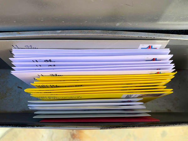 The first batch of handwritten cards and letters, awaiting USPS pickup in the mailbox.