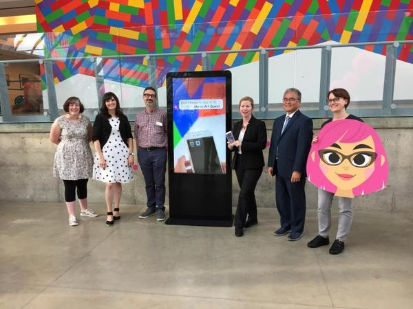 Mark Masuoka has resigned as director of the Akron Art Museum. Masuoka, seen here second from right unveiling the digital tour guide Dot in 2018, had been with the museum since 2013.