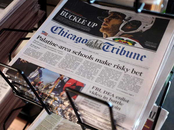 Tribune Publishing, the owner of the <em>Chicago Tribune</em> as well as the New York <em>Daily News</em>, <em>The Baltimore Sun</em> and other newspapers, is cutting pay and asking journalists to take furloughs at many of these newsrooms.