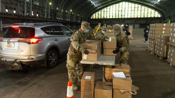 National Guard members help load up boxes at a food distribution center at Kingsbridge Armory in New York City last month.