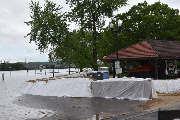 Sandbagging around the River Station on Water Street on Thursday, May 21, 2020.