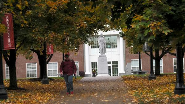 COVID-19 has driven colleges and universities to adapt to a risky financial landscape. Here, a student walks down a path at Norwich University.