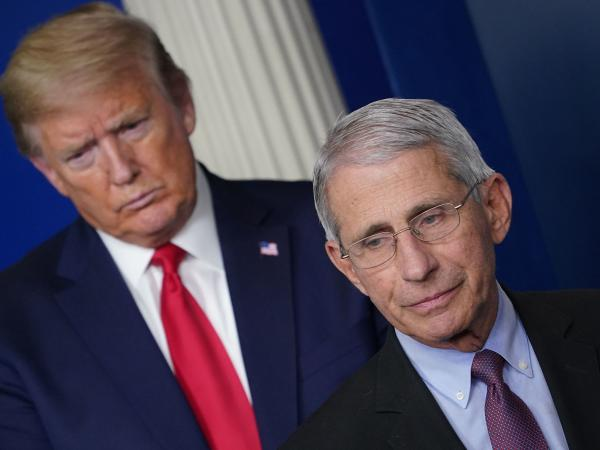 Flanked by President Trump, Dr. Anthony Fauci speaks during a coronavirus task force briefing last month at the White House.