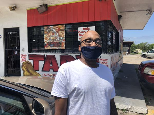 Billy Chadwick wears a mask outside Tad's Cookout in Wichita, where he's a cook.