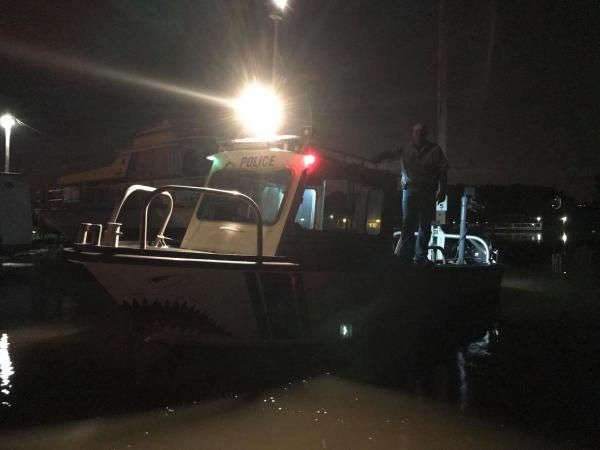 The Fon du Lack Park District Police boat patrol searches for a suspect in Woodford County floodwaters on Thursday, May 21, 2020.