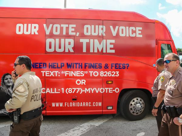 A tour bus, sponsored by the Florida Rights Restoration Coalition, pulls up to a Miami-Dade County courthouse ahead of a hearing aimed at restoring the right to vote under Florida's Amendment 4 on Nov. 8, 2019.