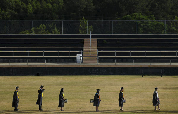 Graduating seniors of a class of just over one hundred line up 10 at a time amid the coronavirus pandemic at Chattahoochee County High School on Friday, May 15, 2020 in Cusseta, Ga. (Brynn Anderson/AP)