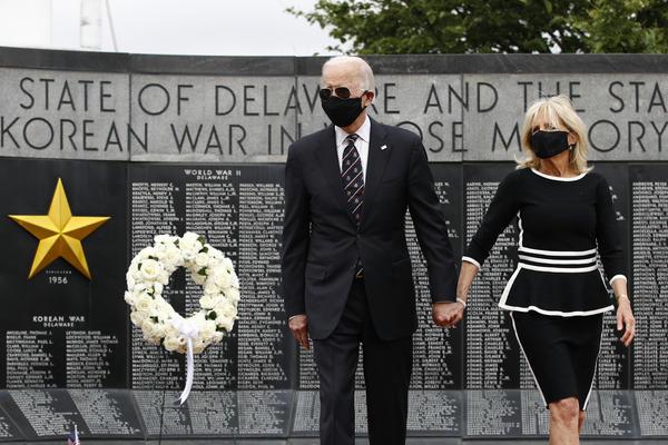 Former Vice President Joe Biden and Jill Biden depart after placing a wreath at the Delaware Memorial Bridge Veterans Memorial Park on Monday.