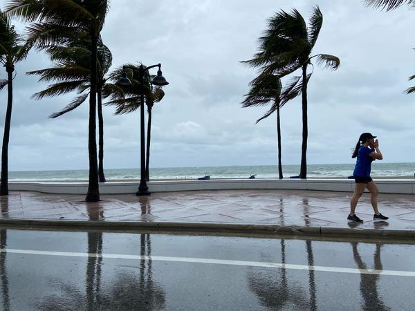 Weather kept many away, save for a few runners who braved the winds by Fort Lauderdale Beach on Memorial Day 2020.