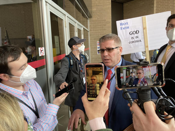 State Rep. Darren Bailey (R, Xenia) speaking to reporters outside the BoS Center on May 20. Bailey was among the first to mount a legal challenge to Gov. J.B. Pritzker's authority in state court