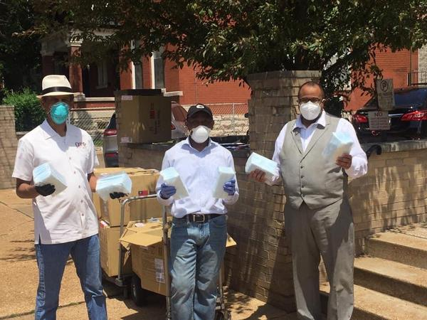 Rev. Darryl Gray, left, Myron Gray, middle, Bishop Lee Scott are distributing masks to St. Louis City and County churches that plan to reopen in June. Masks for city churches were distributed at Lively Stone Church of God.