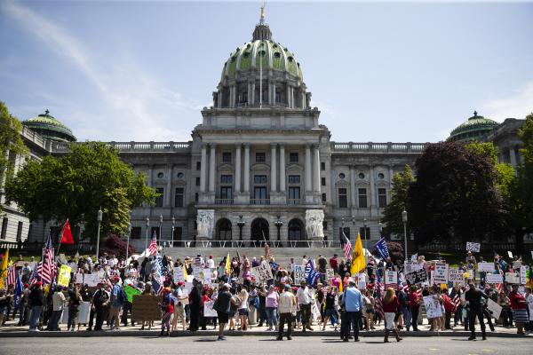 Protesters demonstrate during a rally against Pennsylvania's stay-at-home order at the state Capitol in Harrisburg, May 15. While the public is temporarily banned from the capitol due to the coronavirus outbreak, lawmakers, including one who recently tested positive, are allowed to enter the building.
