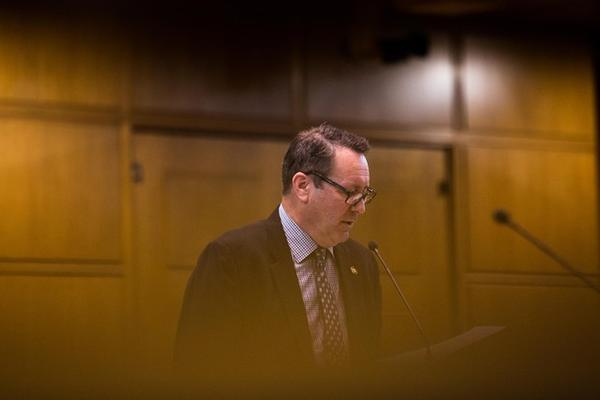 <p>State Rep. Paul Holvey, D-Eugene, introduces legislation on the House floor at the Capitol in Salem, Ore., Tuesday, April 2, 2019.</p>
