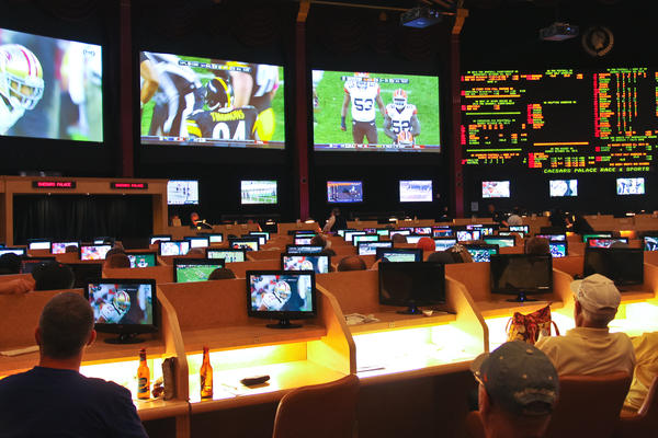 Sports betting in Las Vegas, Nevada, where it's been legal since 1949. 18 states now allow sports betting.