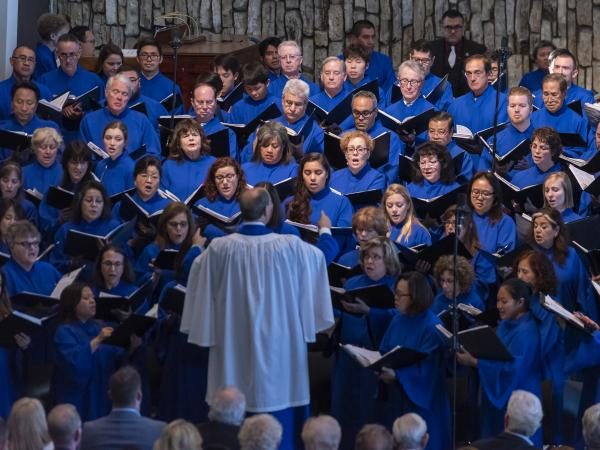 The CDC has revised its guidance to church leaders, deleting a warning about the risk of spreading the coronavirus through choirs and singing. In this photo from last summer, a choir sings at Christ Cathedral in Garden Grove, California.