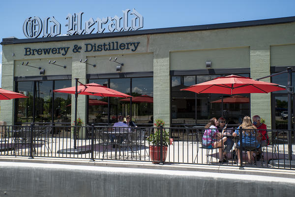 Patrons dine at the Old Herald Brewery and Distillery in Collinsville on May 29. The restaurant can serve customers in-person outside in phase three of Illinois' reopening plan.