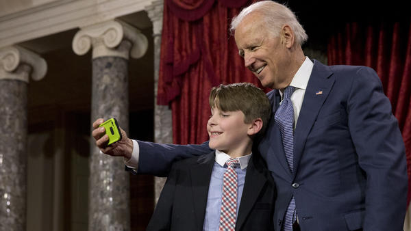 Vice President Joe Biden takes a selfie with Sen. Jeanne Shaheen's grandson A.J. Bellabona during Tuesday's ceremonial swearing-in ceremony.