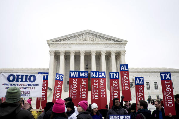 Fans and foes of Obamacare jockeyed for position outside the Supreme Court Wednesday. Inside, the justices weighed arguments in the case of <em>King v. Burwell,</em> which challenges a key part of the federal health law.