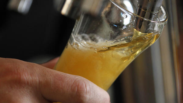 Brewers pay a federal tax on each barrel of beer they produce. Two proposals on Capitol Hill would lower that tax for small brewers, but not everyone's on board.