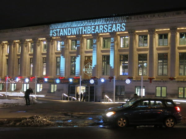 Pro-public lands messages are projected on the McNichols Civic Center in Denver. The Outdoor Retailer and Snow Show moved to Colorado because of a public land use dispute with Utah government leaders.