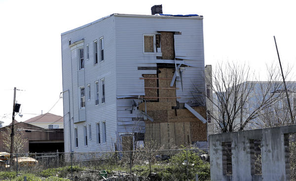 """A building in Newark, N.J., stands near a construction site in a so-called """"opportunity zone"""" in April 2018. The program to spur investment in low-income communities originated in the 2017 tax law."""