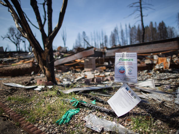 A mobile home park destroyed by last year's wildfire in Paradise, California. Those rebuilding homes and lives say they're getting contradictory messages about whether the water is safe to drink.
