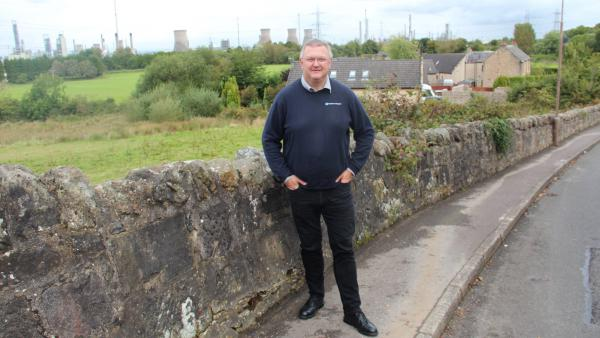 Kevin Ross, president of the Scottish Plastics and Rubber Association, in front of the INEOS Grangemouth refinery and chemical plant.