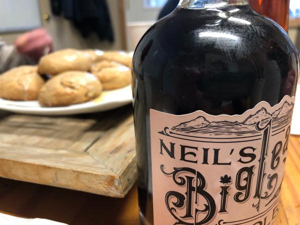 A bottle of Neil's Bigleaf Maple Syrup and some maple scones await taste testers. The finished syrup mostly ends up in Seattle-area restaurants.
