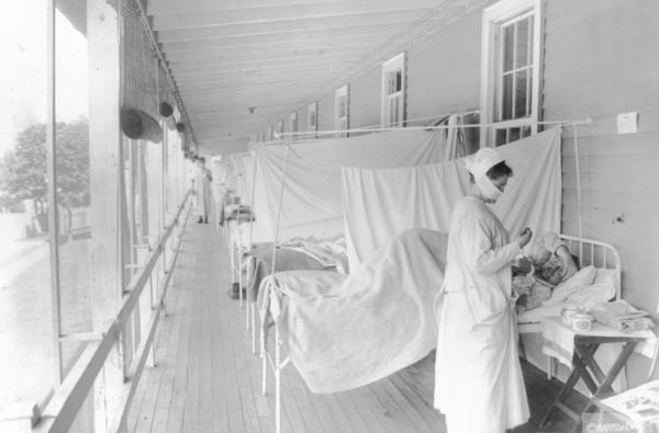 A nurse works in the influenza ward of the Walter Reed hospital in Washington, D.C., in November 1918. Artist Jordan Baseman evokes the era in <em>Radio Influenza, </em>a work of audio art commissioned to mark the centenary of the pandemic.