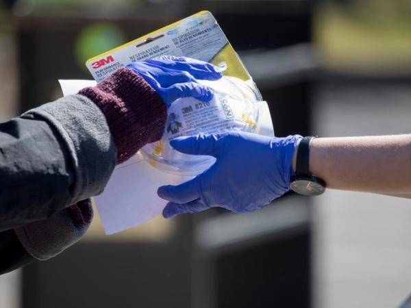 Virginia's Arlington County held its first drive-thru donation for people to drop off unopened and unused personal protective equipment (PPE) for use by first-responders.