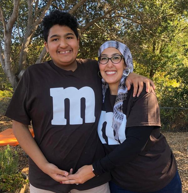 """Feda Almaliti with her son, 15-year-old Muhammed, who has severe autism. """"Muhammed is an energetic, loving boy who doesn't understand what's going on right now,"""" she says."""