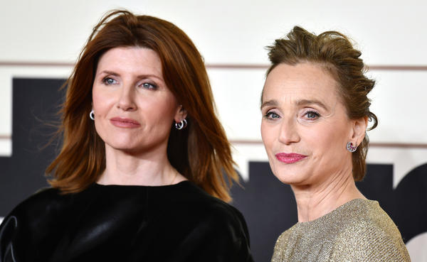 Sharon Horgan (left) and Kristin Scott Thomas play the spouses of soldiers who lead a choir group of women to success, in the new based-on-a-true story film, <em>Military Wives.</em>