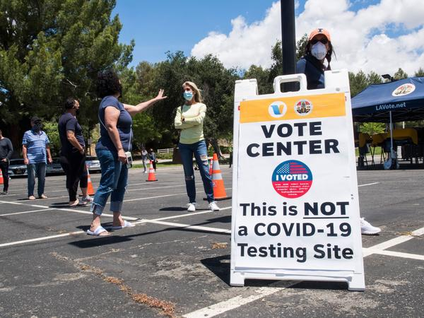 People wait to cast their votes at a polling station on May 12 in Santa Clarita, Calif.