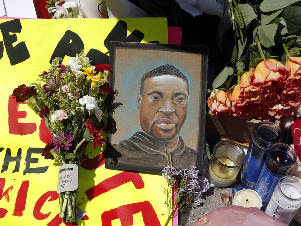 A portrait of George Floyd is part of the memorial for him near the site of his arrest. He died Monday night in Minneapolis; video shared online by a bystander showed a white officer kneeling on his neck during his arrest as he pleaded that he couldn't breathe.
