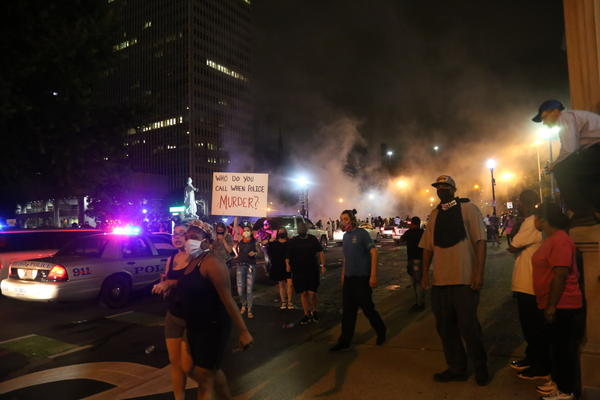 Police attempt to break up the protest with tear gas and rubber bullets minutes after shots are fired into the crowd in Louisville, Ky.
