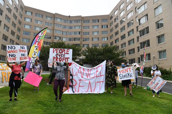 Renters in the Woodner apartment building in Washington, D.C., protest on May 28 to demand that their rent be forgiven during the COVID-19 pandemic.