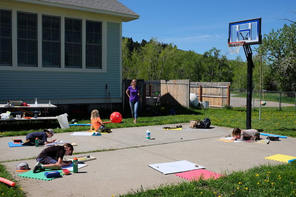 Several students at Cottonwood Elementary in Gallatin County, Montana work on projects while staying socially distanced on May 28, 2020.
