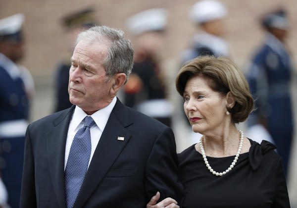 George W. and Laura Bush, the former president and first lady, at the funeral of his father in 2018.