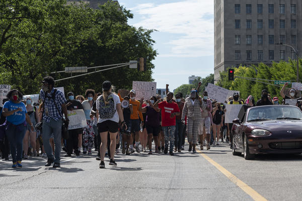 Protesters march in downtown St. Louis on Monday.