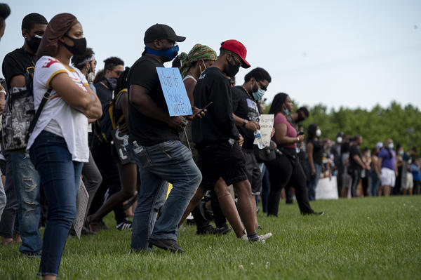 Gathered in a large circle beneath the Arch Monday, protesters were asked to step forward each time statements about their personal experiences with police applied to them.