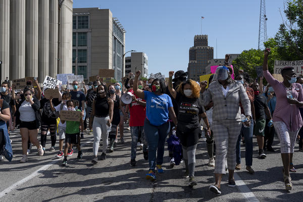 Demonstraters chanted as they marched to protest the killing of George Floyd.